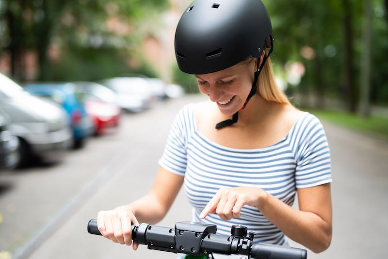 woman wearing black electric scooter helmet