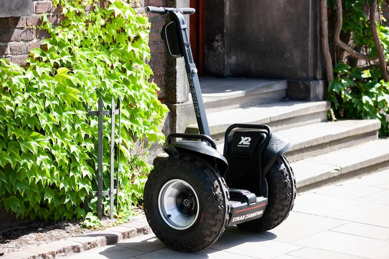 Big Segway parked in front of a building