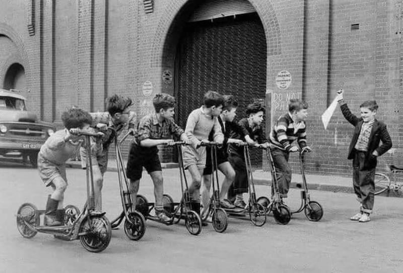 "A Kid's Scooter Race at the Paddy's Markets"" by Frank Burke. Sydney, Australia Sydney, 1956"