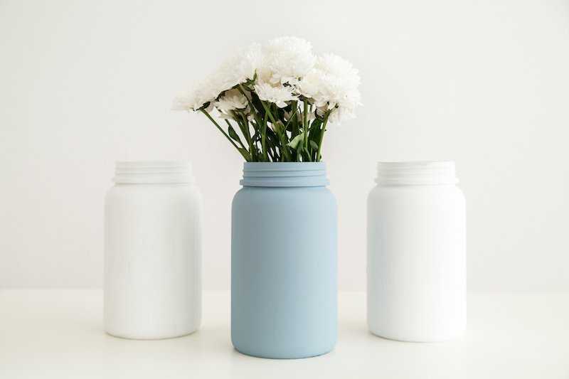 the importance of repurposing items - flower vases made of repurposed jars